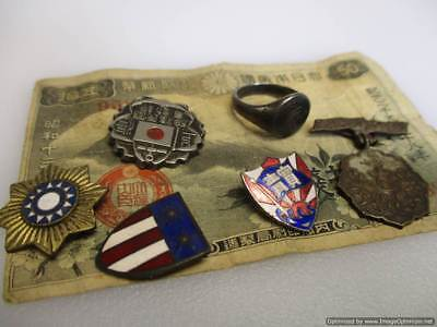 Grouping of WW2 Japanese badges, medals, pins, Ring and Currency