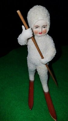 """antique German 4.25"""" Snowbaby Skier (detached pole and skis)"""