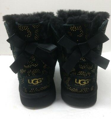UGG Girls' Mini Bailey Bow Metallic Conifer Boot Little Kids Black Gold Size 3
