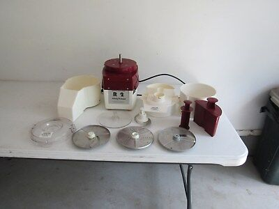 Robot Coupe R2 Food Processor with Cutter Bowl and Continuous Feed Attachments.