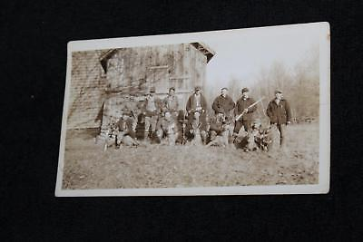 1920s-30s Hunters Sitting on Deer & with Rifles in Front of Barn Vintage Photo