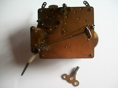 Vintage Westminster clock movement with brass key, spare parts