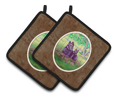 Carolines Treasures  7263PTHD Schipperke and puppy Pair of Pot Holders