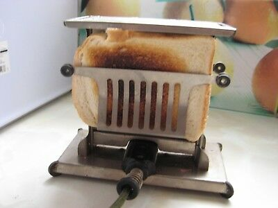 "Vintage Toaster by "" Universal "" circa 1920s."