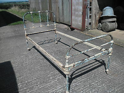 Antique Iron 3' Single Bedstead on castors, in distressed painted condition