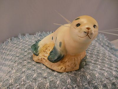 VTG PORCELAIN SEA w/WHISKERS SITTING ON A ROCK HAND PAINTED w/RUBBER PROTECTORS