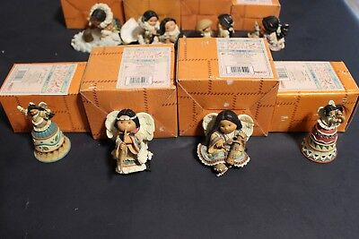 Assortment of Enesco Friends of the Feather Figurines and Canoe Display Box