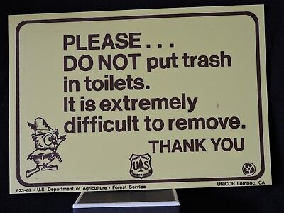 """Woodsy Owl & the U.S. Forest Service sign """"Do Not Put Trash in Tiolet"""" sign"""