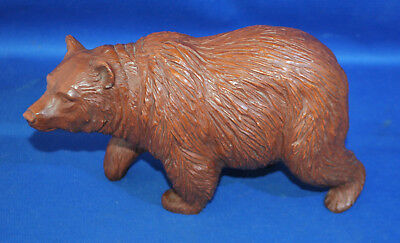 A quite large moulded resin antique Black Forest style standing bear,