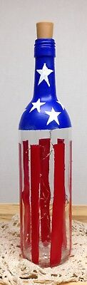 Hand painted wine bottle based on our America flag. With lighted cork.