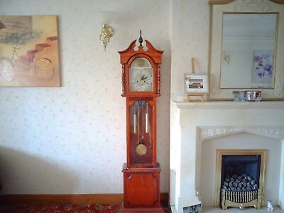 Grandmother triple-weight chiming clock, mahogany case, German 8 day movement.