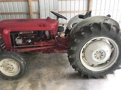 601 ford farm tractor with post hole digger