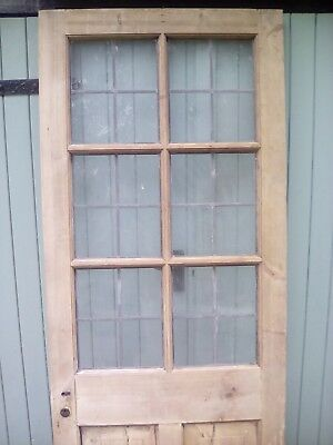 Period leaded glass door in stripped pine