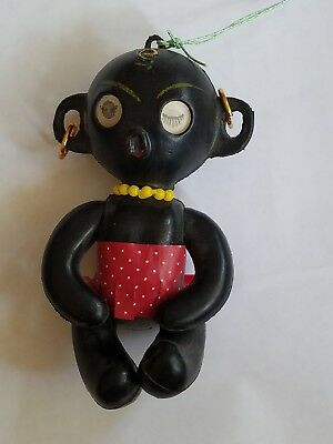Vintage plastic jointed Black African Doll with Flicker Eyes made in Hong Kong