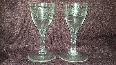 Victorian drinking glass x 2, large foot, multi cut stem ,grape vine  etched