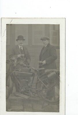 Real photo postcard of an early motorcycle outside a pub in very  good condition