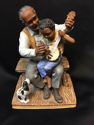 Homco Masterpiece Porcelain Elderly American African Holding a Boy & Instrument