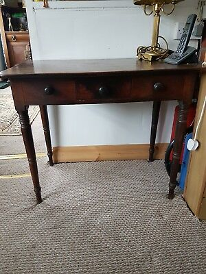 Antique oak  table/desk with opening center draw.