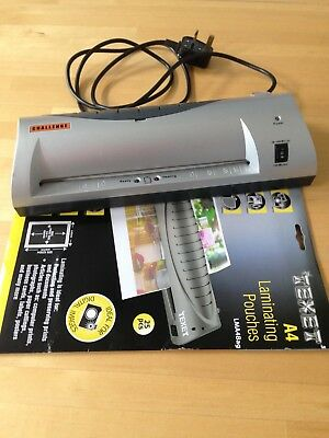 Laminator with approx 20 pouches. Used rarely in good working order