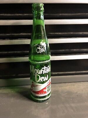 Vintage Mountain Dew 10oz soda bottle filled by Ed & Gene Hillbilly