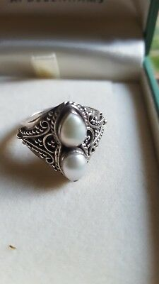 Metal detecting finds silver and pearl ring.