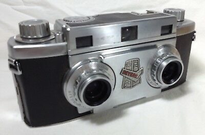 Revere stereo 33 camera with viewer and big collection of vintage slides.