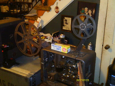 BELL & HOWELL FILMSOUND 179 MODEL E WITH SPEAKER AND COVERS 16MM PROJECTOR 1950s