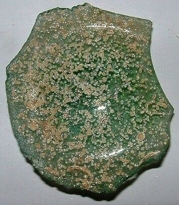 ancient roman glass fragment with  nice patina amazing. very nice color.