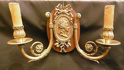 Lovely Antique pair of french empire bronze sconces with woman effigys