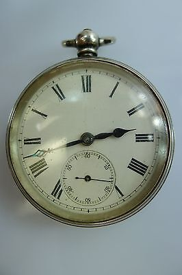 An Antique/vintage Silver Mechanical Pocket Watch With A Key & Metal Watch Case