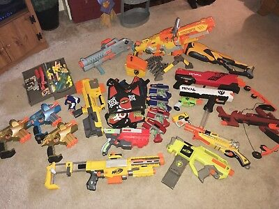 21 Nerf Gun Lot, Ammo Box, 4 Vests, Clips, Ammo, Retail Over $975.00 Make Offer