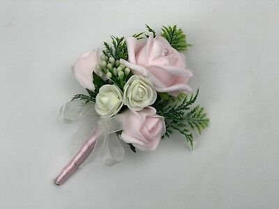 Wedding buttonhole ,corsage ,ladies flowers ,mothers pin on groom bride bouquet