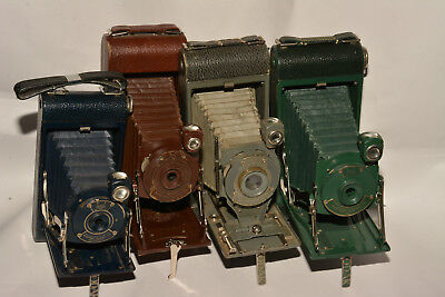 Set Of Four Colored Kodak Cameras; Blue, Grey, Brown,green. Instant Collection