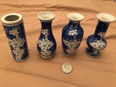 Lot Of Four Blue And White Floral 4 Inch Ceramic Vases.