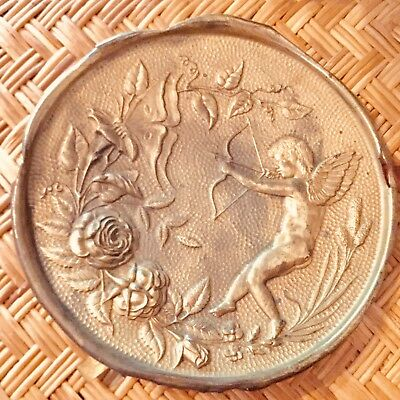 Antique Victorian Brass Repousse Flu Cover Depicting Cupid Shooting A Butterfly
