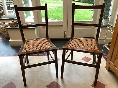 Pair of vintage/ antique wooden chairs with rattan seats in brown wood