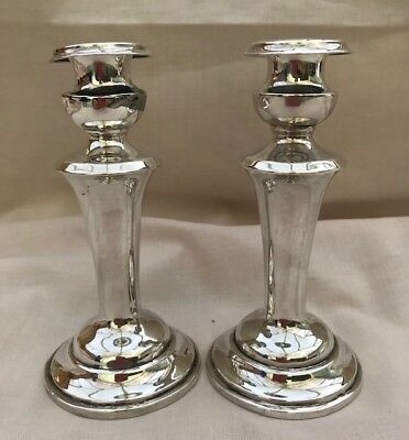 A Pair Of Solid Silver Victorian Candle Sticks
