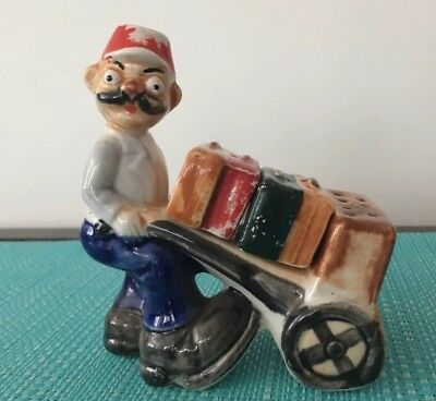 Man Pushing Luggage In Cart Salt And Pepper Shakers.
