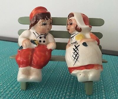 Man And Lady On Bench Salt And Pepper Shakers.