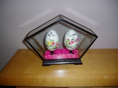 2 chinese flower painted eggs in wooden glass case