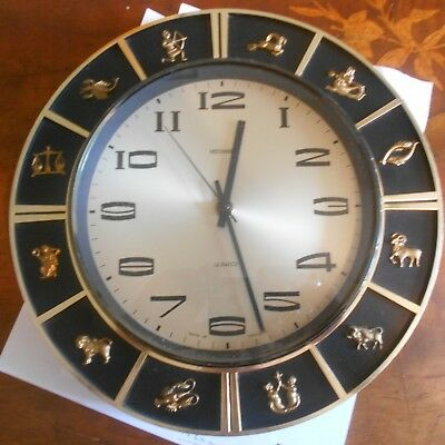 "vintage metamec zodiac wall clock, 11 1/2"" in diameter"