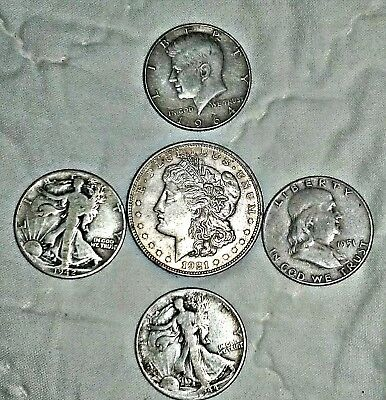 Lot of 90% silver coins, Morgan dollar and 4 half dollars