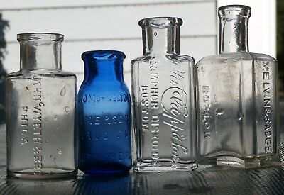 LOT OF FOUR ANTIQUE EMBOSSED MEDICINE REMEDY BOTTLES, 1800's