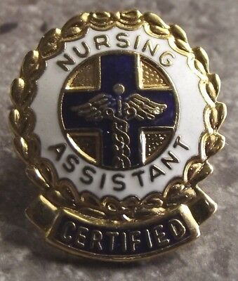 "e2829)       LOVELY VINTAGE ENAMELED ""NURSES ASSISTANCE"" CERTIFIED BADGE"