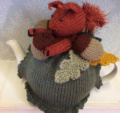 hand knitted tea cosy with squirrel,acorns and Oak Leaves ideal autumn cosy