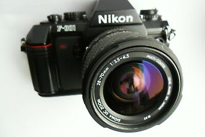Nikon F 301 35mm SLR with Sigma 28-70mm lens and case. Excellent FWO