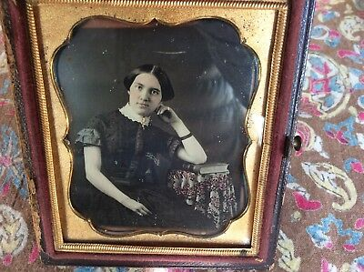 A 6-plate Daguerreotype of A Young Woman, Wearing A Short-sleeved Dress, 1849/50
