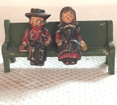 Vintage Cast Iron Amish Man and Women Figurines  on a Green Wood Bench  GVC
