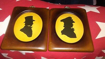 Vintage pair of silhouette's in wooden frames