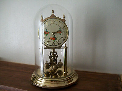 Vintage Anniversary German Kundo clock with its glass dome